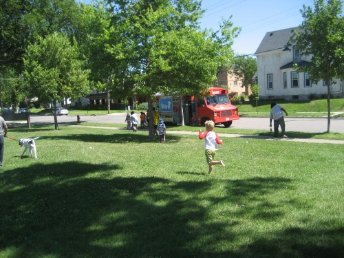 Kids running to line up for the food truck.